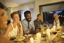 Friends laughing at dinner party — Stock Photo