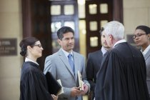 Judges and lawyers talking in courthouse — Stock Photo