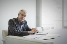 Portrait confident senior businessman working in conference room — Stock Photo