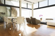 Dining and living area in modern house — Stock Photo