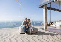 Couple using digital tablet on modern balcony — Stock Photo