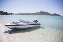 Speedboat beached on shore — Stock Photo