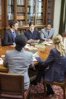 Judge and lawyers talking in chambers — Stock Photo