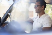 Man driving car on sunny day — Stock Photo