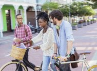 Friends walking together on city street — Stock Photo