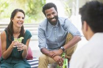 Friends talking at party — Stock Photo