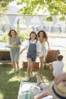 Happy modern family running through park together — Stock Photo