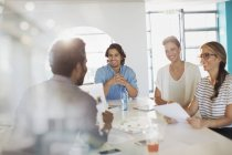 Smiling creative business people brainstorming, planning in conference room meeting — Stock Photo