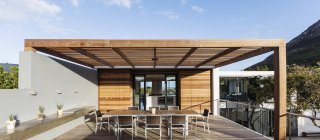 Sunny modern, luxury home showcase exterior patio — Stock Photo