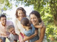 Happy caucasian family playing with each others outdoors — Stock Photo