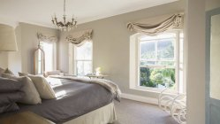Interior of Sunny luxury bedroom during daytime — Stock Photo
