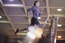 Female runner running above stairs — Stock Photo