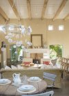 Rustic dining table in luxury home — Stock Photo
