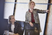 Businesswoman pointing in conference room meeting — Stock Photo