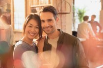 Portrait smiling affectionate couple hugging in cafe — Stockfoto