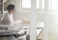 Interior designer working at computer in home office — Stock Photo