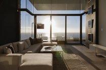 Modern living room overlooking ocean — Stock Photo