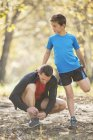 Father and son stretching and preparing to run — Stock Photo