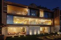 Modern house illuminated at night — Stock Photo