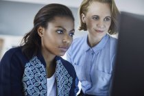 Focused businesswomen working at computer at modern office — Stock Photo