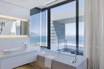 Cozy bathroom interior in modern house — Stock Photo