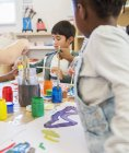 Students painting in classroom indoors — Stock Photo