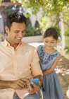 Father and daughter looking at cell phone — Stock Photo
