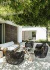 Armchairs and sofa on luxury patio — Stock Photo