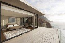 Modern bedroom opening onto balcony — Stock Photo