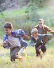 Boys running in field during daytime — Stock Photo