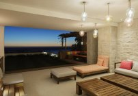 Luxury patio overlooking ocean at night — Stockfoto