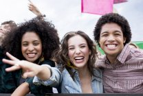 Enthusiastic friends at music festival — Stock Photo