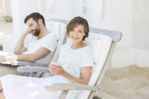 Couple relaxing in lawn chairs outdoors — Stock Photo