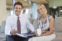 Business people talking on sofa — Stock Photo