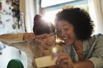 Young happy women taking picture together — Stock Photo
