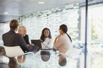 Business people talking in meeting in office building — Stock Photo