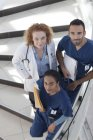 Doctor and nurses on modern hospital steps — Stock Photo