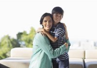 Mother and son hugging outdoors — Stock Photo