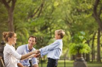 Family playing together in park — Stock Photo