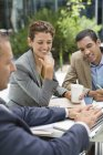 Business people talking in meeting outdoors at modern office — Stock Photo
