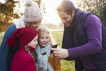 Family showing smartphone to family — Stock Photo