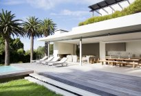 Lounge chairs on deck of modern house — Stock Photo