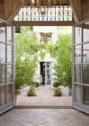 View of courtyard through French doors — Stock Photo