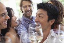 Friends toasting each other at party — Stockfoto