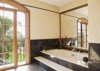 Marble bathtub in luxury bathroom — Stock Photo