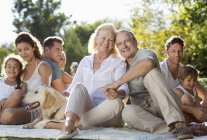 Family relaxing together in backyard — Stock Photo