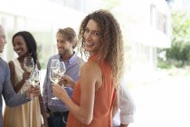 Young attractive Woman smiling at party — Stock Photo