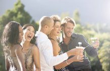 Young attractive Friends laughing together at party — Stockfoto
