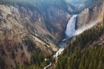 Aerial view of waterfall in rocky canyon — Stock Photo