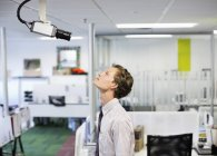 Businessman examining security camera in office — Stock Photo